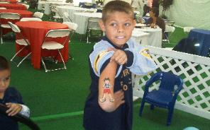 Boy with painted tattoo on his arm